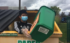 Sophomore Patrick Li collects bins of paper from fellow recycling club members to empty out into the main paper dumpster. While the majority of clubs have transitioned to conducting fully virtual meetings, there are a handful of activities that continue to offer in-person events. However, following Governor Whitmer's most recent announcement, all clubs and sports have been required to discontinue in-person activity.